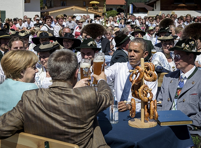 KRUEN, GERMANY - JUNE 07: U.S. President Barack Obama shares a Bavarian breakfast with German Chancellor Angela Merkel and her husband Joachim Sauer prior the summit of G7 nations on June 7, 2015 in Kruen, Germany. In the course of the two-day summit G7 leaders are scheduled to discuss global economic and security issues, as well as pressing global health-related issues, including antibiotics-resistant bacteria and Ebola. Several thousand protesters have announced they will seek to march towards Schloss Elmau and at least 17,000 police are on hand to provide security. (Photo by Steffen Kugler - Pool/Getty Images)