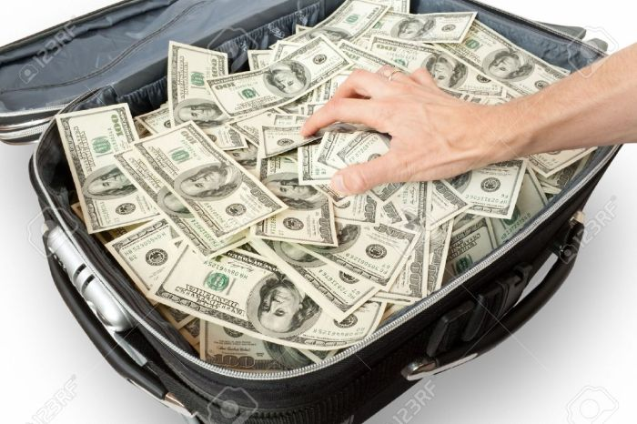 6143374-greed-lot-of-money-in-a-suitcase-with-hand-Stock-Photo-stack
