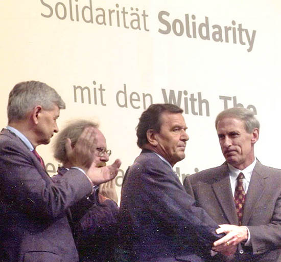 coats_schroeder-shaking-hands